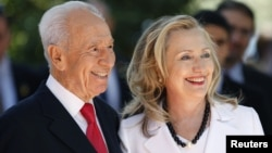Israel's President Shimon Peres (L) stands with U.S. Secretary of State Hillary Clinton before their meeting in Jerusalem July 16, 2012