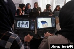 In this Monday, Jan. 22, 2018 photo, Afghan coders practice at the Code to Inspire computer training center in Herat province, western Afghanistan.