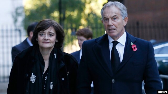 FILE - Former British Prime Minister Tony Blair and his wife Cherie arrive for the annual Remembrance Sunday ceremony at the Cenotaph, in central London, November 2013.