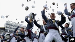 FILE - The 2014 graduating class of the U.S. Military Academy at West Point in West Point, N.Y., toss their hats during commencement ceremonies, May 28, 2014.
