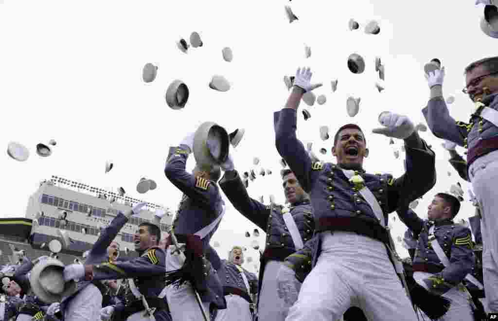 The 2014 graduating class of the U.S. Military Academy toss their hats during commencement ceremonies at West Point, New York.