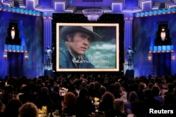 FILE - Heath Ledger is shown on a screen during a memorial to the late actor at the 14th annual Screen Actors Guild Awards in Los Angeles, Jan. 27, 2008.