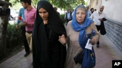 Mary Rezaian, mother of detained Washington Post correspondent Jason Rezaian, right, and Jason's wife Yeganeh leave court in Tehran, Iran, Aug. 10, 2015. Rezaian was one of four American detainees freed by Iran on Jan. 16, 2016.