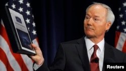 Former Rep. Asa Hutchinson (R-AR), a consultant of the National Rifle Association, shows and discusses the findings and recommendations of the National School Shield Program at the National Press Club in Washington Apr. 2, 2013.