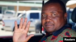 Mothetjoa Metsing, leader of the Lesotho Congress for Democracy (LCD), gestures after speaking to Reuters in the capital Maseru, Feb. 26, 2015.