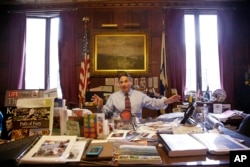 In this June 5, 2014 photo, Springfield Mayor Domenic Sarno sits behind his city hall desk.