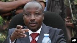 M23 rebel leader Bishop Jean Marie Runiga, addressing press conference, Bunagana, Congo, Jan. 3, 2013.