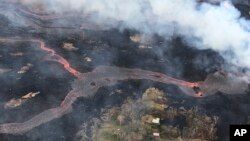 This May 23, 2018, photo shows a helicopter overflight of Kīlauea volcano's lower East Rift Zone near Pahoa, Hawaii.