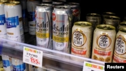 Various cans of alcohol-free beers, including those from Asahi, Kirin and Suntory, are displayed on a supermarket shelf in Tokyo, Japan March 9, 2021. (REUTERS/Ritsuko Ando)