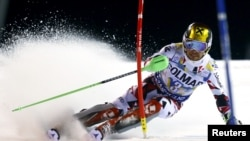 Marcel Hirscher of Austria clears a gate during the first run in the men's slalom at the Alpine Skiing World Cup in Madonna di Campiglio, northern Italy, December 22, 2015. In his second run, a drone crashed directly behind him.