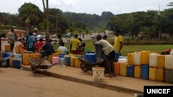 FILE - Residents of Cameroon's capital Yaounde often queue for hours to fill jerry cans with water during periods of severe shortages. (UNICEF)