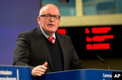European Commission Vice-President Frans Timmermans speaks during a media conference at EU headquarters in Brussels on Dec. 20, 2017.