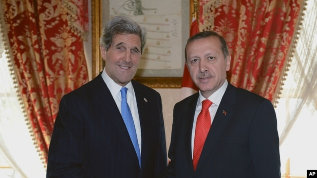 Turkish Prime Minister Recep Tayyip Erdogan, right, and US Secretary of State John Kerry shake hands as they pose for cameras before a meeting in Istanbul, Turkey, April 7, 2013.