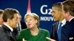 G20峰會在法國康城舉行﹐美國總統奧巴馬(右二)﹑法國總統薩科齊(左)和德國總理默克爾(左二)會晤﹐共商解決歐洲債務危機。
