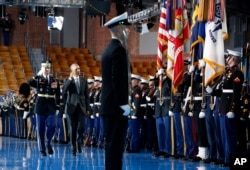 Army Col. Jason T. Garkey escorts President Barack Obama as he inspects the Armed Forces Honor Guard during an Armed Forces Full Honor Farewell Review for the president, Jan. 4, 2017, at Conmy Hall, Joint Base Myer-Henderson Hall, Virginia.