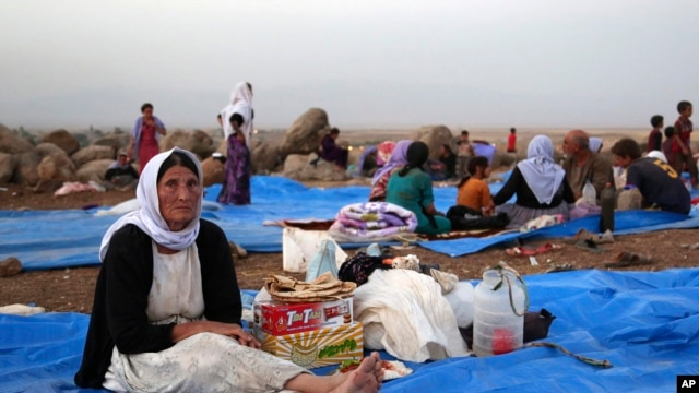 Displaced Iraqis from the Yazidi community settle at a camp at Derike, Syria, Aug. 10, 2014.