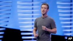 FILE - Facebook CEO Mark Zuckerberg delivers the keynote address at the F8 Facebook Developer Conference in San Francisco, California, April 12, 2016. In a vision laid out Thursday, Zuckerberg now wants to remake Facebook to help counter isolationism, promote global connections and address social ills.