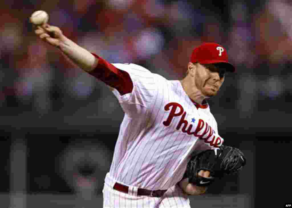 Philadelphia Phillies starting pitcher Roy Halladay delivers to a Cincinnati Reds batter during the fifth inning of Game 1 of baseball's National League Division Series, Wednesday, Oct. 6, 2010, in Philadelphia. Halladay pitched a no-hitter. The Phillie