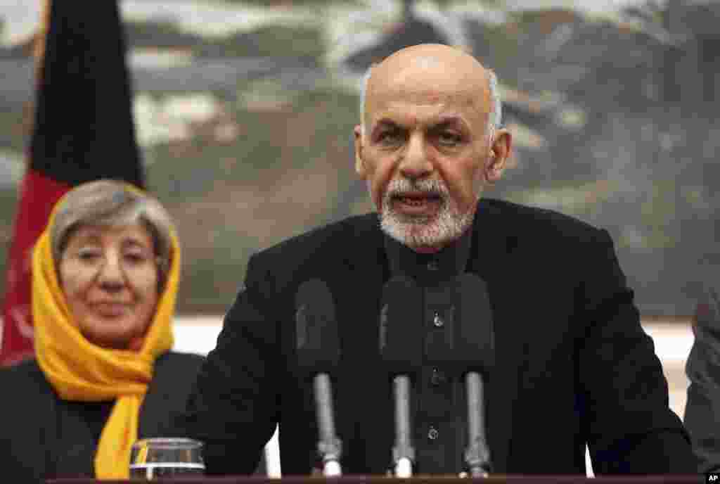 "Afghanistan's President Ashraf Ghani speaks during a press conference at the presidential palace in Kabul, Afghanistan Wednesday, Dec. 10, 2014. Ghani said, ""The Afghan government condemns in the strongest language the inhuman and unjustifiable practices practices detailed in the report."""