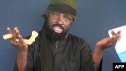 Abubakar Shekau shugaban kungiyar Boko Haram yayinda yake magana a sabon faifan bidiyon da ya fitar.