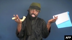 This screen grab image taken on February 18, 2015 from a video made available by Islamist group Boko Haram shows its leader, Abubakar Shekau, making a statement at an undisclosed location.