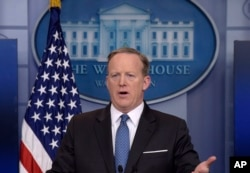 FILE - White House press secretary Sean Spicer speaks during the daily briefing at the White House in Washington.