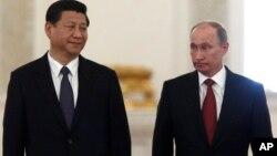 Си Цзипин и Владимир Путин