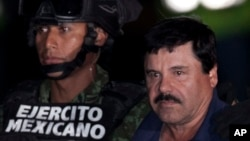 "FILE - Mexican drug lord Joaquin ""El Chapo"" Guzman, right, is escorted by soldiers and marines to a waiting helicopter, at a federal hangar in Mexico City, Jan. 8, 2016."