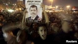 Supporter of President Morsi during celebration of his dismissal of former defense ministers, Tahrir Square, Cairo, Aug. 13, 2012.