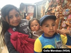 Children in Tzotzil community in the village of San Juan Chamula, Mexico, ask tourists to buy handicrafts, Feb. 15, 2016.