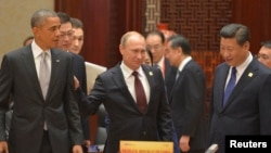 (L-R, front) U.S. President Barack Obama, Russian President Vladimir Putin and Chinese President Xi Jinping attend a plenary session during the Asia Pacific Economic Cooperation (APEC) Summit in Beijing, Nov. 11, 2014.