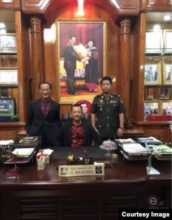 Wan Kuok-koi is photographed in the office of General Hing Bun Hieng, head of the Prime Minister Bodyguard Unit, in Phnom Penh, Cambodia. (Courtesy of Facebook)