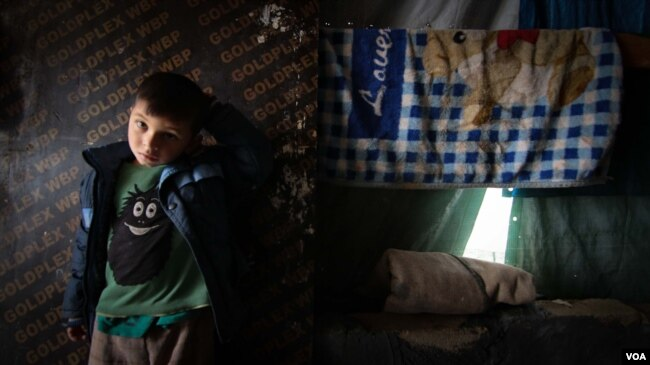 Made of tarpaulin, the tents that Syrians must call home are vulnerable to wind and rain. (John Owens for VOA)