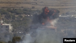 Fire and smoke rise after shells exploded in the Syrian village of Bariqa, close to the ceasefire line between Israel and Syria, near Alonei Habashan on the Israeli occupied Golan Heights November 7, 2012.Israel has asked the U.N. Security Council to act