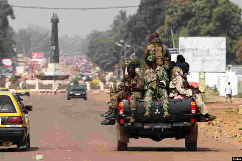 Soldiers patrol a street in Bangui, Central African Republic, January 1, 2013.
