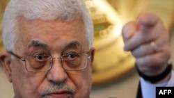 Tổng thống Palestine Mahmoud Abbas trong cuộc họp báo ở Cairo, ngày 24/1/2011
