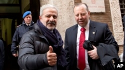 FILE - Reggio Calabria head of Police Guido Longo (L) gives the thumbs up next to FBI special agent Leo Taddeo following a joint Italian-U.S. authorities' press conference on an anti-Mafia blitz with numerous arrests reported on both sides of the Atlantic, Rome.