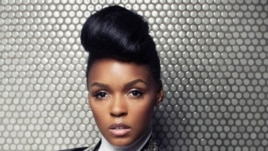FILE - In this Aug. 12, 2013 file photo, American R&B and soul musician, composer and record producer, Janelle Monae poses for a portrait at Dream Downtown, in New York.