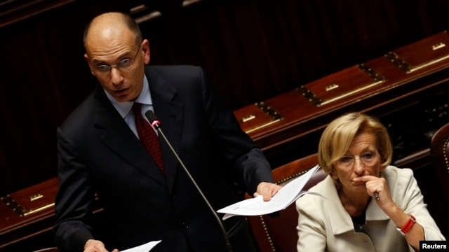 Newly appointed Italian Prime Minister Enrico Letta (L) speaks next to Foreign Minister Emma Bonino at the Lower House of the parliament in Rome, April 29, 2013.
