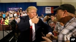 Republican presidential candidate Donald Trump greets supporters during a rally, Aug. 25, 2015, in Dubuque, Iowa.