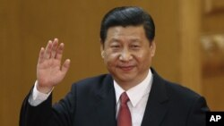New Communist Party General Secretary Xi Jinping waves in Beijing's Great Hall of the People Nov. 15, 2012.