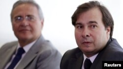 Congressman Rodrigo Maia (R), the new House Speaker, looks on near Brazil's Senate President Renan Calheiros, during a meeting with Brazil's interim President Michel Temer at the Planalto Palace in Brasilia, Brazil, July 14, 2016.