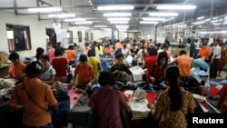 Workers tailor and arrange clothing at a garment factory at Hlaing Tar Yar industry zone