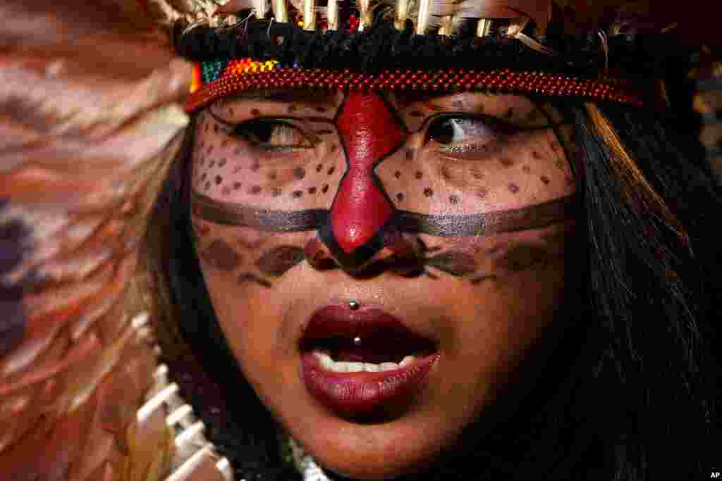 An Indigenous woman attends a march to protest the policies of Brazilian President Jair Bolsonaro and in favor of women's rights and the demarcation of Indigenous lands in Brasilia, Brazil.