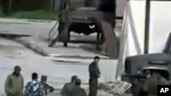 Image from amateur video made available by Shaam News Network Jan. 16, 2012, purports to show Syrian security forces in Hama, Syria. AP CANNOT INDEPENDENTLY VERIFY THE CONTENT, DATE, LOCATION OR AUTHENTICITY OF THIS MATERIAL.