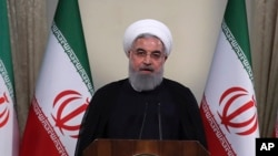 FILE - In this photo released by official website of the office of the Iranian Presidency, President Hassan Rouhani addresses the nation in a televised speech in Tehran, Iran, May 8, 2018.