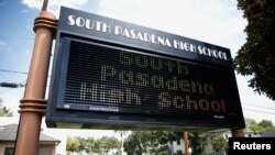 A sign is seen outside South Pasadena High School in South Pasadena, California, August 19, 2014.