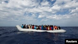 Off the Libyan coast, 104 sub-Saharan Africans in a rubber dinghy await rescue. The charity Migrant Offshore Aid Station provided this courtesy photo Oct. 4, 2014.