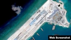 Satellite image of what is claimed to be an airstrip at Fiery Cross Reef in the Spratly islands in the disputed South China Sea. Web Screemshot theguardian.com.
