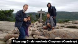 Thai real estate agent Ploysong Chaichoochote Chapman (second from right) with her family. They live in Syracuse, New York